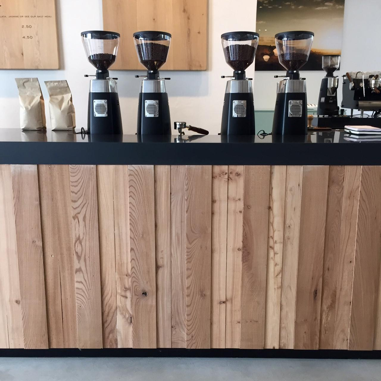 View of the bar with four grinders